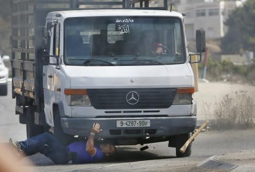 Σοκ! Έλιωσε Ισραηλινό με το φορτηγό του (ΠΡΟΣΟΧΗ, ΣΚΛΗΡΕΣ ΕΙΚΟΝΕΣ)
