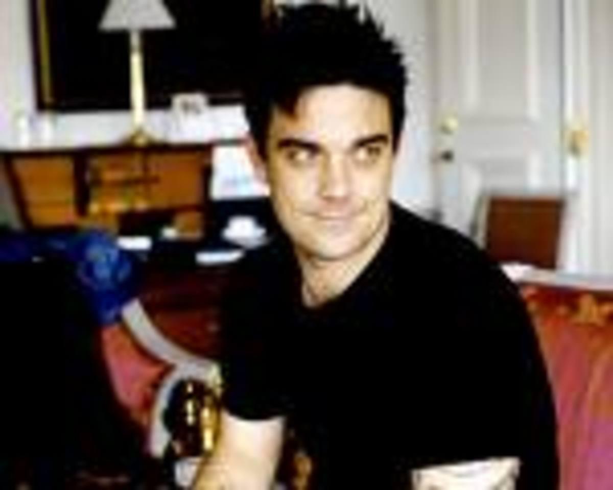 Θέλει παιδιά ο Robbie Williams! | Newsit.gr