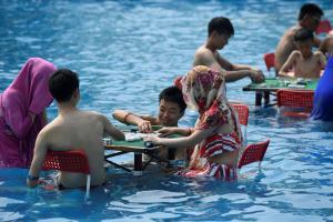 """Σε κατάσταση """"κίτρινου συναγερμού"""" η Κίνα, λόγω καύσωνα"""