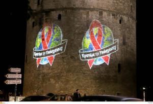 Φωταγώγηση του Λευκού Πύργου και κεριά στην Αριστοτέλους για την παγκόσμια ημέρα κατά του AIDS [pics, vid]
