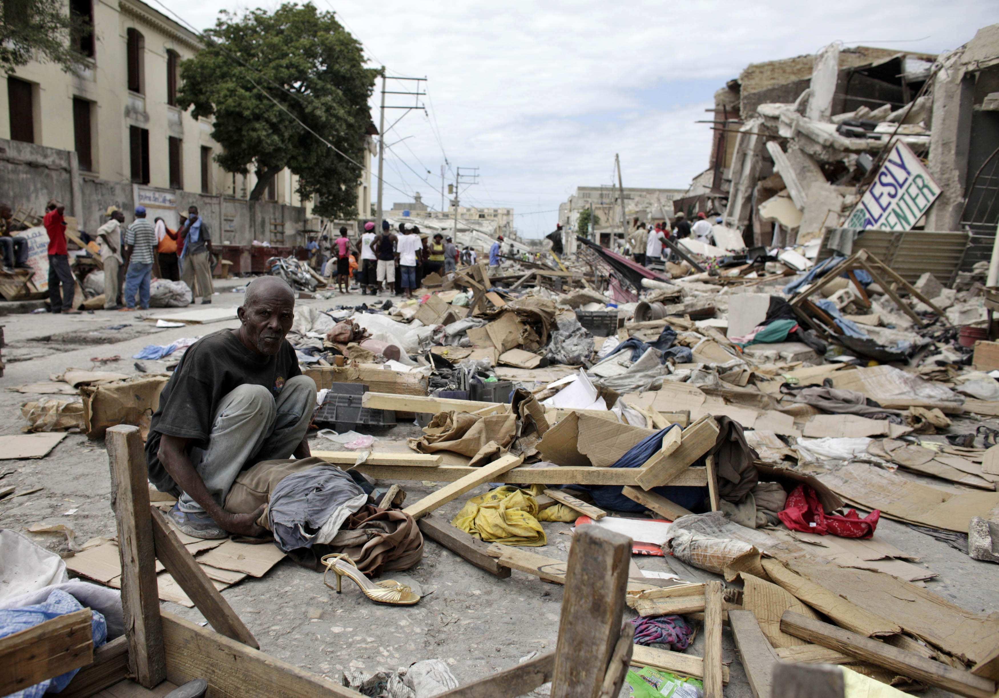 Ο πόνος στα μάτια των Αϊτινών δεν στερεύει ποτέ. ΦΩΤΟ REUTERS