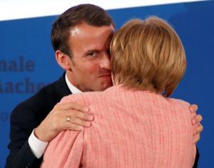 Άκαμπτο το Βερολίνο για το χρέος – Ύστατη προσπάθεια από Μακρόν και Γιούνκερ να «μαλακώσουν» την Μέρκελ