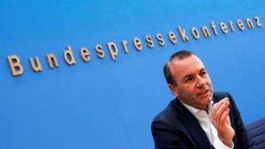 Γιατί ο Βέμπερ ξεκινά την εκστρατεία για τις ευρωεκλογές από το Άουσβιτς